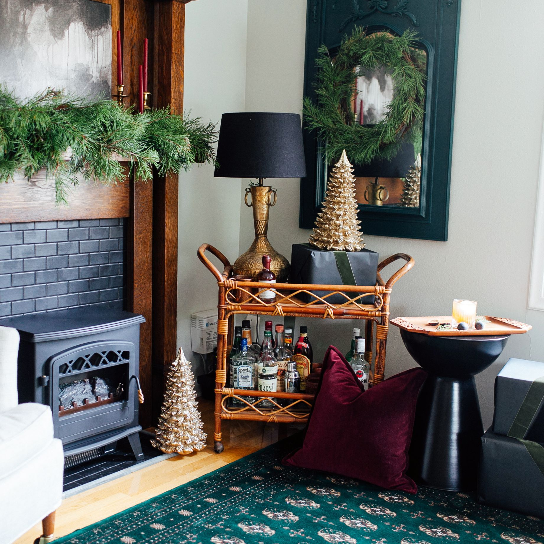 "<p>Claire Brody of <a href=""http://clairebrodydesigns.com/"">Claire Brody Designs</a> created a festive and cozy space around her <a href=""http://www.homedepot.com/p/Warm-House-Ottawa-20-in-Retro-Style-Floor-Standing-Electric-Fireplace-ORF-10340/205386656&#x3B;jsessionid=D994DF53768E193976E6E2D2CE79D18A"">retro inspired floor-standing fireplace</a>. The <a href=""http://www.homedepot.com/p/Martha-Stewart-16-in-Winter-s-Wonder-Gold-Glitter-Christmas-Tree-KX1063-G/205930726"">gold metallic Christmas trees</a> create a holiday splash and contrast well against the rich and moody colors in the room.  </p>"