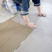 Human leg, Jeans, Floor, Flooring, Denim, Foot, Ankle, Walking shoe, Barefoot, Toe,