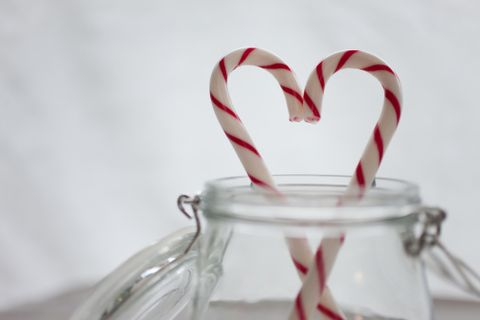 Red, Candy cane, Candy, Love, Polkagris, Stick candy, Heart, Kitchen utensil, Still life photography, Confectionery,