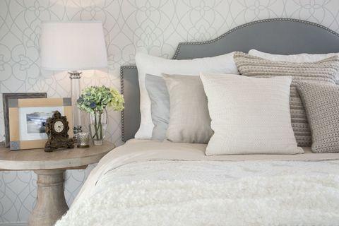 Room, Interior design, Textile, Wall, Furniture, Linens, Pillow, Bedding, Home, Cushion,