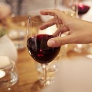 Woman holding glass of red wine