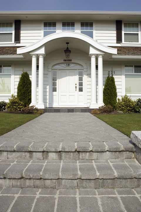 Road surface, Property, Residential area, Home, Real estate, Walkway, House, Facade, Door, Fixture,