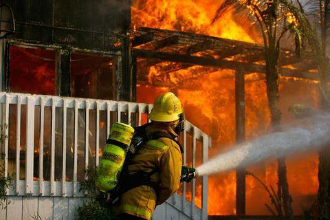 Firefighter battles house fire in California