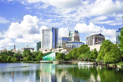 Blue, Daytime, Cloud, Tower block, Metropolitan area, Urban area, Reflection, Neighbourhood, City, Real estate,