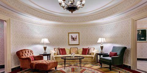 Interior design, Room, Floor, Flooring, Ceiling fixture, Light fixture, Ceiling, Living room, Furniture, Couch,
