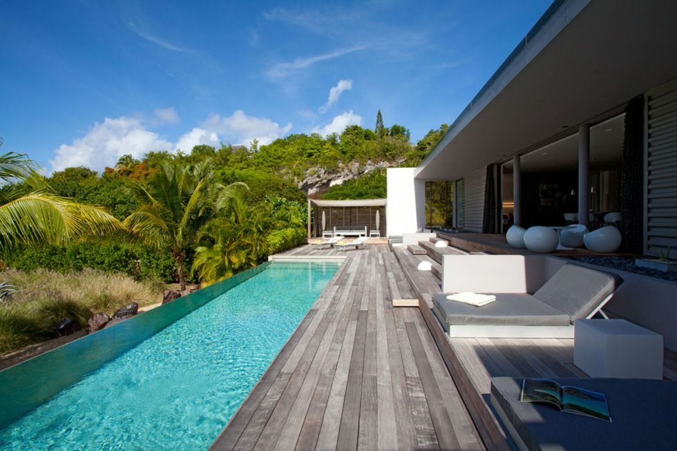 "<p>Just steps away from the beach in Petit Cul de Sac Bay, <a href=""https://www.airbnb.co.uk/rooms/531810"" target=""_blank"">this luxury villa</a> combines architectural minimalism with effortless luxury. <em></em></p>"