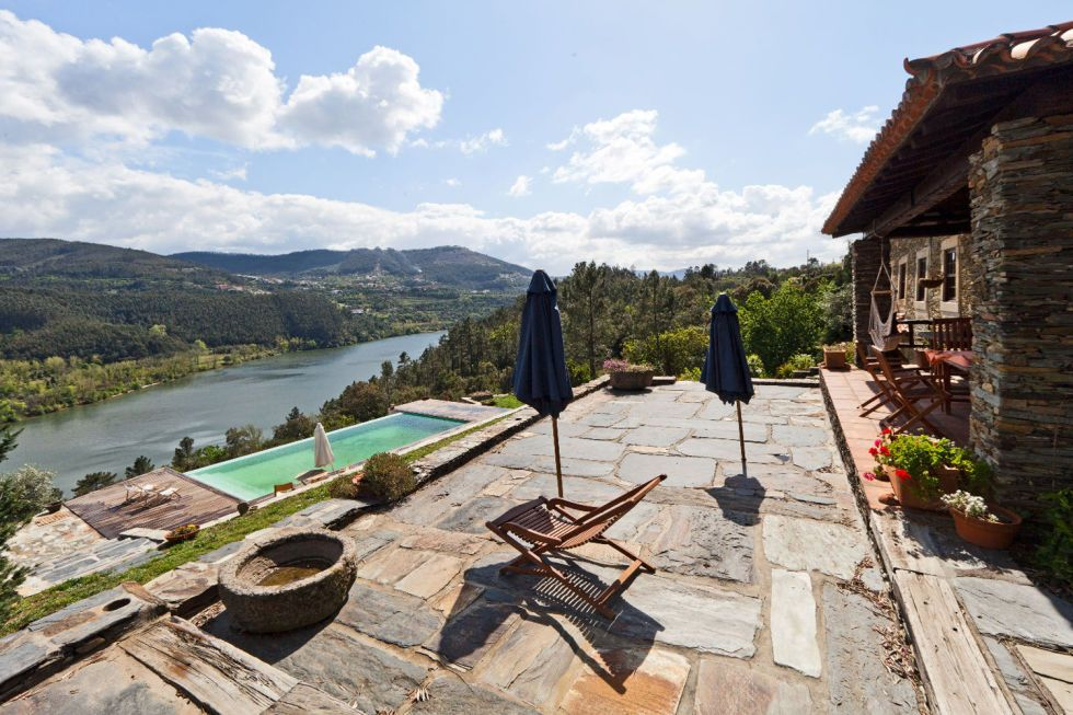 "<p>Travel to the banks of the Douro River to <a href=""https://www.airbnb.co.uk/rooms/403641"" target=""_blank"">this restored country farmhouse</a>. It features farm animals, a private salt water infinity pool and a kitchen with a wood burning stove. As if that wasn't enough, the breathtaking views of the river makes this the perfect destination for a tranquil getaway. <em></em></p>"