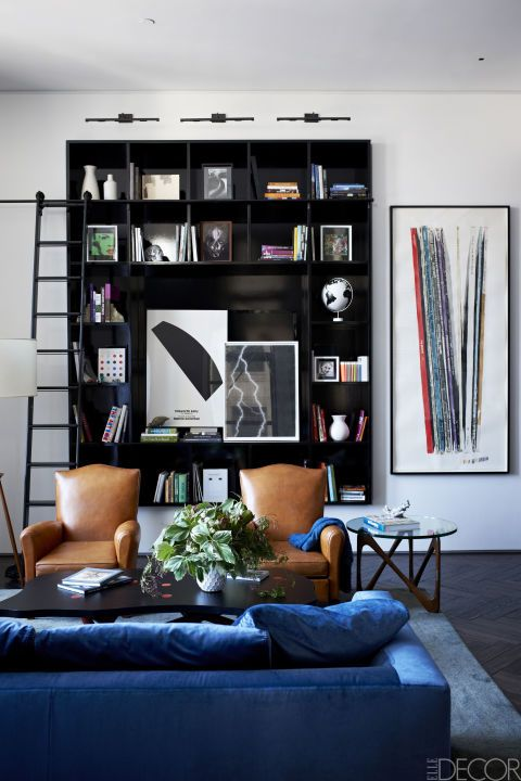 Room, Interior design, Living room, Furniture, Wall, Couch, Interior design, Shelving, Pillow, Home,
