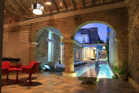 Lighting, Ceiling, Floor, Interior design, Wall, Flooring, Tile, Real estate, Light fixture, Arch,