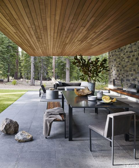 Floor, Interior design, Shade, Grey, Tints and shades, Tile, Houseplant, Stone wall, Flagstone, Outdoor structure,