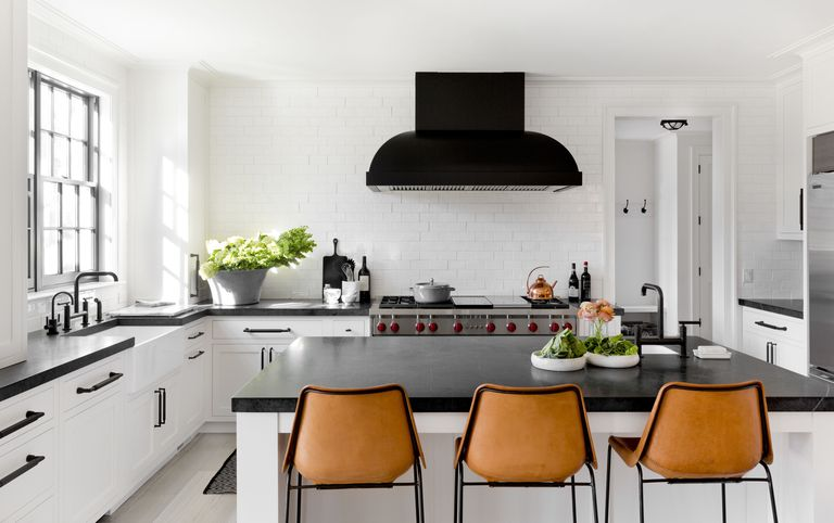 Custom stainless steel range hood with black powder coat paint designed by Tamara Magle and photographed for Elle Decor Magazine.