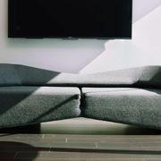 Room, Display device, Television set, Interior design, Couch, Flat panel display, Television, Black, Comfort, Grey,