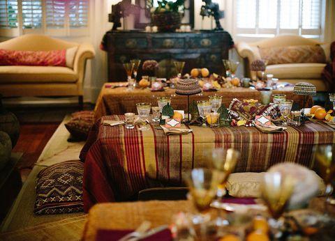 Room, Interior design, Furniture, Living room, Couch, Table, Interior design, Tablecloth, Serveware, Home accessories,