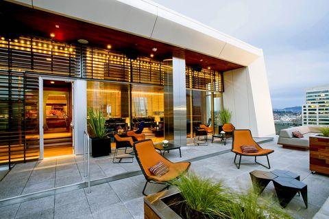 Furniture, Real estate, Outdoor furniture, Houseplant, Apartment, Armrest, Commercial building, Flowerpot, Condominium, Resort,
