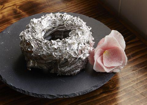 Petal, Serveware, Cuisine, Dessert, Foil, Artificial flower, Silver, Baked goods, Gluten, Powdered sugar,