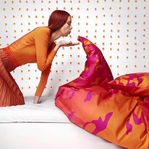 Textile, Purple, Orange, Pattern, Wedge, Cushion, Photo shoot, Sandal, Model, Flesh,
