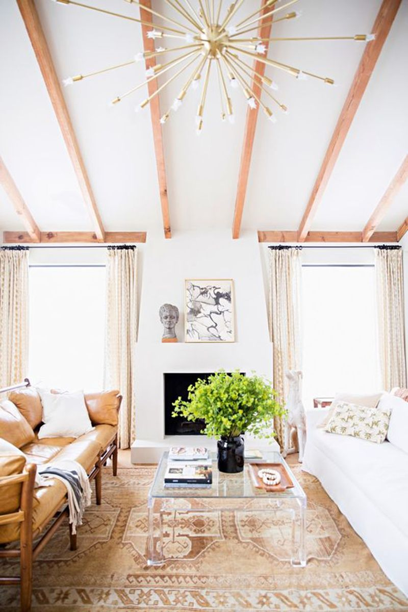 """<p>A neutral color palette keeps things light during warmer months. Add a printed rug in a similar hue for eye-catching appeal. </p><p><a href=""""http://domino.com/""""></a><em><a href=""""http://domino.com/"""" target=""""_blank"""">Via Domino</a></em></p>"""