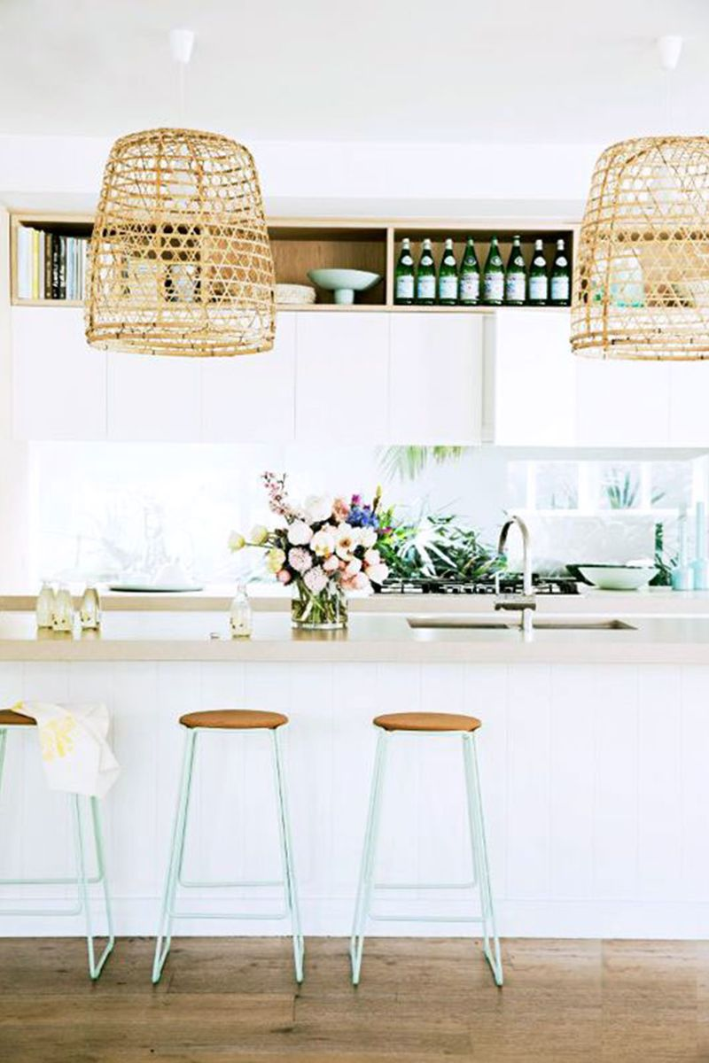 Whether it be via chair or hanging lights, wicker is summer's favorite material. 