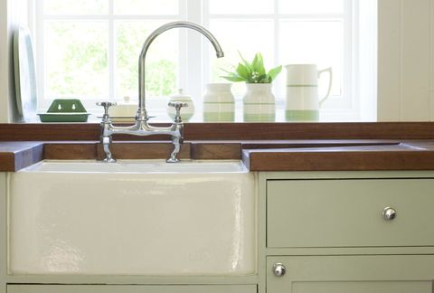 Room, Plumbing fixture, Property, Tap, Chest of drawers, Sink, Interior design, Sideboard, Cabinetry, Drawer,