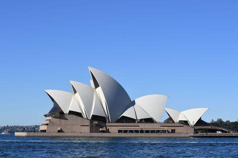 Sky, Architecture, Landmark, Opera house, Brutalist architecture, Tourist attraction, Urban design,