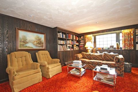 Wood, Interior design, Room, Floor, Flooring, Ceiling, Living room, Wall, Couch, Interior design,