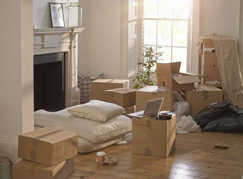 Room, Interior design, Floor, Shipping box, Flooring, Box, Home, Living room, Cardboard, Interior design,