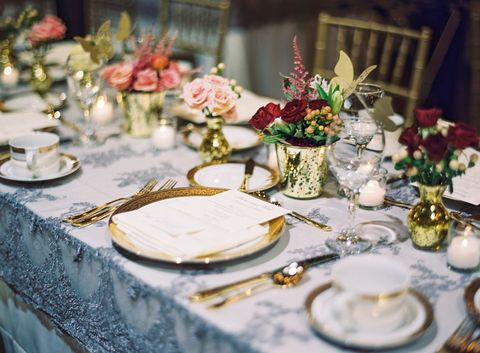This Tablescape Brings A Bit Of Shine To Traditional Fall Decor With Glimmering Gold Vases Gilded Flatware And Beaded Tablecloth Via Wedding Sparrow