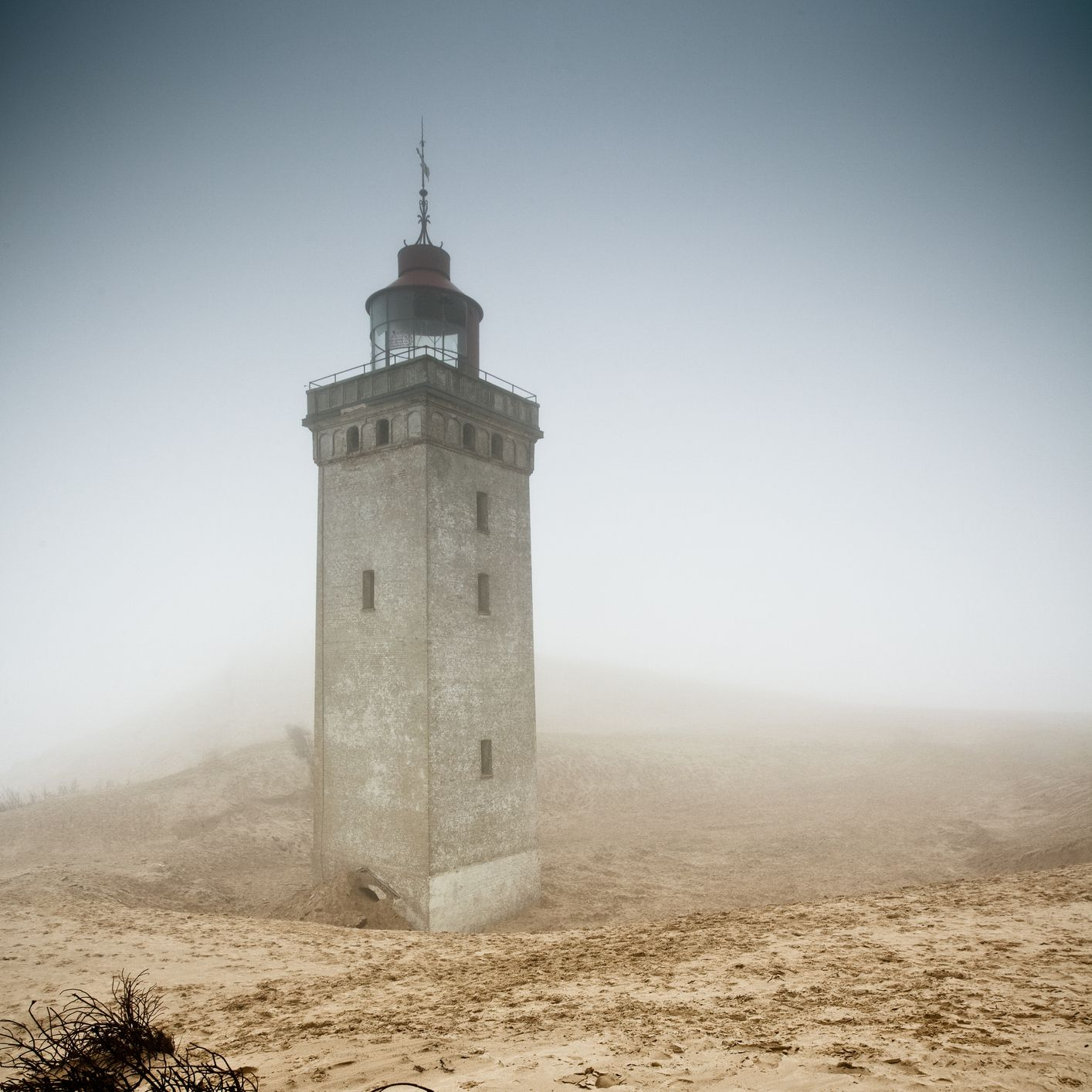 <p>When it became clear that if the sand dunes didn't completely engulf this&nbsp&#x3B;century-old structure first, it would eventually topple into the North Sea due to coastal erosion, the lighthouse was left to the elements. It is located on the northern coast of Denmark.</p>