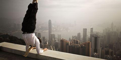 Human leg, Tower block, Elbow, Atmospheric phenomenon, Urban area, Knee, Tower, Metropolitan area, Waist, Thigh,
