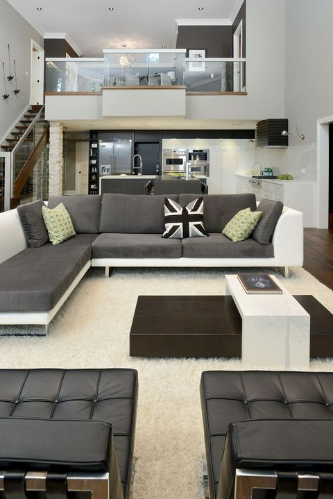 Interior design, Room, Floor, Green, Living room, Wall, Home, Couch, Table, Flooring,