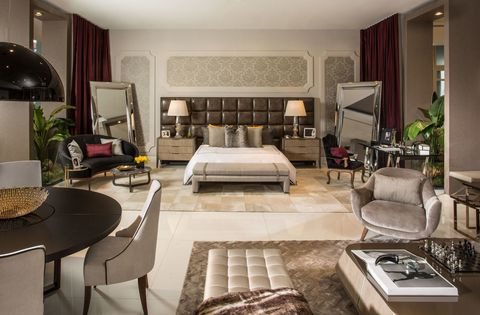<p>Cary Fernandez paired with Dolce &amp; Gabbana for her first appearance at the Design House, and created a bedroom concept revolving around deep maroons and beiges. Curvy arrangements and leather pieces help to exude D&amp;G's authentic elegance. </p>