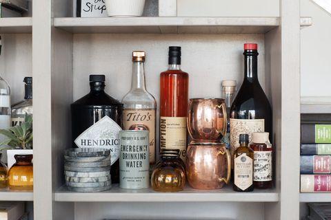 Glass bottle, Bottle, Alcohol, Alcoholic beverage, Drink, Distilled beverage, Liquid, Barware, Bottle cap, Shelving,
