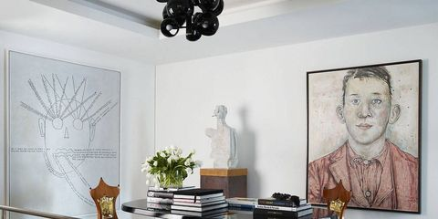 Room, Interior design, Table, Furniture, Wall, Interior design, Ceiling, Grey, Picture frame, Iron,