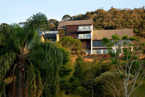 Vegetation, Property, Tree, Real estate, Building, House, Facade, Residential area, Home, Roof,