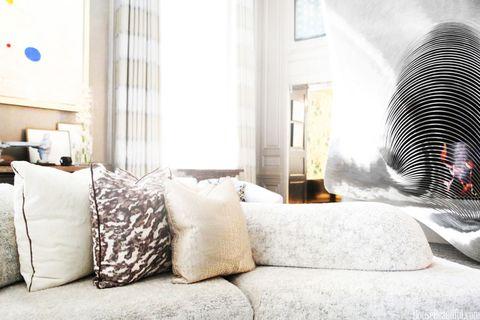 Room, Interior design, Textile, Wall, Pillow, Linens, Interior design, Grey, Bedding, Throw pillow,