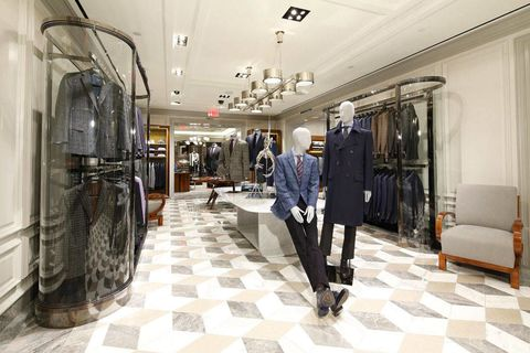 Floor, Textile, Flooring, Coat, Ceiling, Clothes hanger, Boutique, Outlet store, Light fixture, Tile,