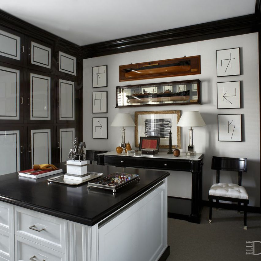 "The cabinetry, ebonized-wood countertop, and fabric-covered wardrobe doors in the dressing room of <a target=""_blank"" href=""http://www.elledecor.com/design-decorate/house-interiors/g857/luis-bustamante-madrid-apartment/"">Luis Bustamante's Madrid apartment</a> are all custom made"