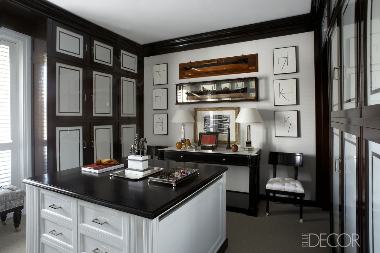 The Cabinetry, Ebonized Wood Countertop, And Fabric Covered Wardrobe Doors  In The