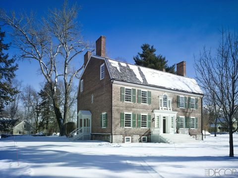 "228-year-old <a target=""_blank"" href=""http://www.elledecor.com/design-decorate/house-interiors/g28/historical-home-tour-upstate-new-york/"">Ludlow Homestead, in Claverack, New York</a> was built in 1786 with bricks made on-site, and the shutters are painted in Farrow & Ball's Calke Green; the structure to the left, originally the summer kitchen, is now used as a potting shed. Peter Spears and Brian Swardstrom transformed the home"