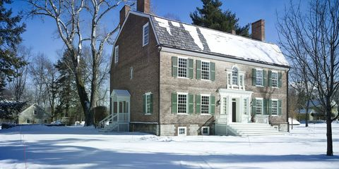 """228-year-old <a target=""""_blank"""" href=""""http://www.elledecor.com/design-decorate/house-interiors/g28/historical-home-tour-upstate-new-york/"""">Ludlow Homestead, in Claverack, New York</a> was built in 1786 with bricks made on-site, and the shutters are painted in Farrow &amp; Ball's Calke Green; the structure to the left, originally the summer kitchen, is now used as a potting shed. Peter Spears and Brian Swardstrom transformed the home"""