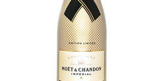 Yellow, Glass bottle, Bottle, Font, Metal, Beige, Label, Cone, Wine bottle, Brand,