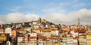 Town, Residential area, City, Urban area, Metropolitan area, Neighbourhood, Facade, Cloud, Landscape, Building,