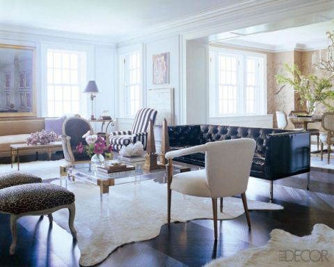 In a living room of a home designed by Nate Berkus and Anne Coyle, the white  cowhide rugs are from Anne Coyle Interiors and the white armchair is  vintage ... - 20 White Living Room Furniture Ideas - White Chairs And Couches