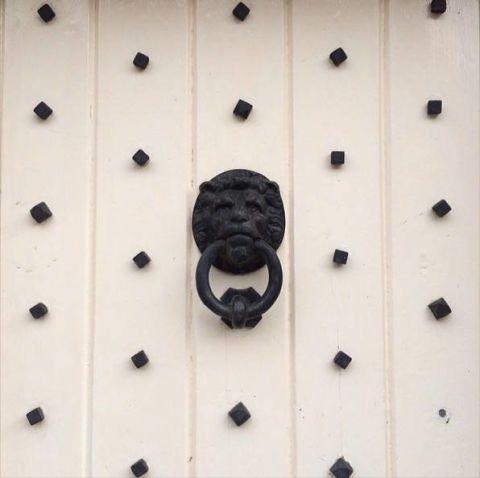 A Wolf Door Knocker Seen Here.