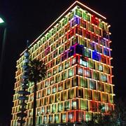 Facade, Night, Colorfulness, Apartment, Commercial building, Tower block, Condominium, Mixed-use, Landmark, Metropolitan area,