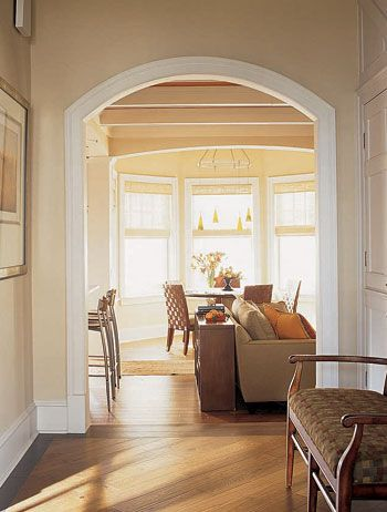 Frame Focal Points This elegant archway designed by architect Geoffrey Mouen focuses attention on a bay window in the great room drawing visitors into ... & Passageways