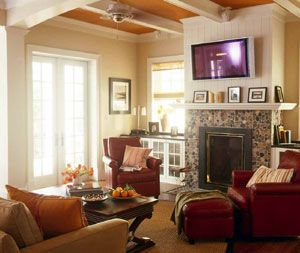 ... Leather Chairs, Sea Grass Rug, And Grass Window Shades Bring An Earthy  Flair To The Family Room Decor. Interior Designer Kathy Andrews Used Orange  And ...