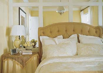 In The Master Suite At Rear Of First Floor Camel Colored Fabrics Deepen And Add Dimension To Yellow Color Scheme A Mirrored Wall Behind