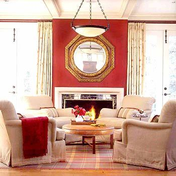 A Classic Brick Red Paint Adds Comforting Warmth To The Sunroom Where Owners Often Linger By Fireplace