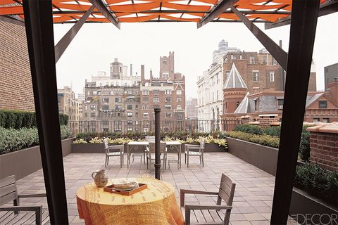 Table, Real estate, Apartment, Residential area, Outdoor furniture, Outdoor table, Roof, Daylighting, Shade, Mixed-use,